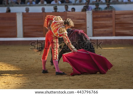 Pozoblanco, Spain - September 24, 2011: The Spanish Bullfighter Jose Luis Moreno bullfighting with the crutch in the Bullring of Pozoblanco, Spain