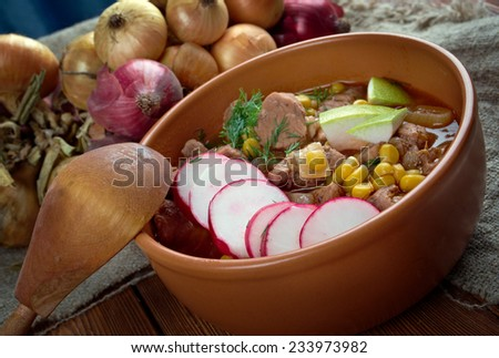 Pozole - traditional soup Mexico.broth rich soup made with pork, red chiles, radishes, cilantro - stock photo