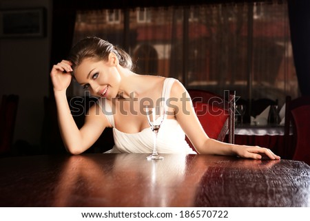 Pportrait of young happy beautiful woman in restaurant. - stock photo