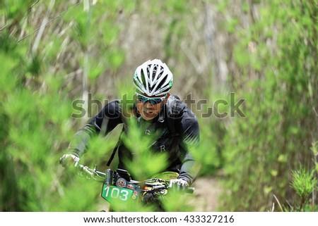 Prachinburi, Thailand -June 05, 2016: Thailand Enduro Series 2016. Mountain bike races at Kao E-TO, which combines cross-country mountain bike downhill, on June 4-6, 2016.  - stock photo