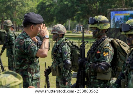"PRACHUAP KHIRI KHAN, THAILAND - NOV 24, 2014: Lieutenant General Kritsada Areeratchakul, Director of Army Training Command is preside over ""The Ultimate Soldier"" maneuver of Thai Royal Army, THAILAND."