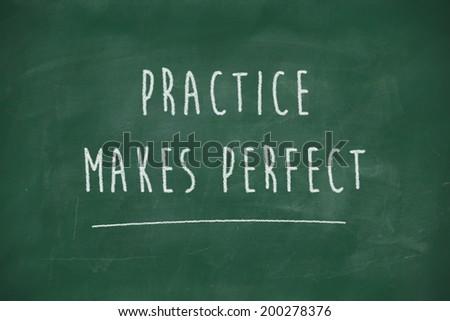 Practice makes perfect handwritten on school blackboard - stock photo