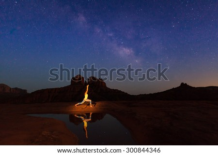 Practicing Yoga at Cathedral Rock Under the Milky Way - stock photo
