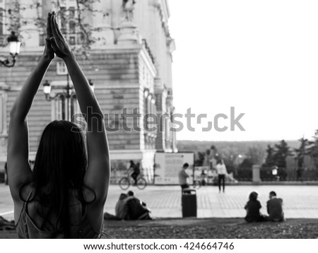 Practicing Yoga at sunset in Madrid - stock photo