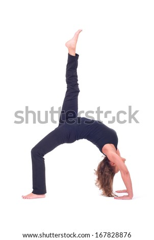 Practicing Yoga exercises. Young  woman doing  Yoga exercises in studio on white background.  Pose name: Bridge pose - Urdhva Dhanurasana