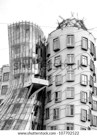 PRAGUE - APRIL 29: The Dancing House in the center of Prague. Seen during gloomy, winter day. The building was designed by Vlado Milunic and Frank Gehry. Built in 1996. Prague, April 29, 2012. - stock photo