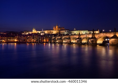 Prague at night with the Charles Bridge and Castle
