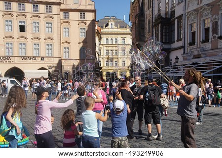 PRAGUE - AUG 31, 2016 - performer entertaining chidren with bubbles,Stare Mesto, Old Town of  Prague, Czech Republic