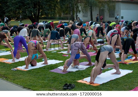 PRAGUE - AUGUST 23, 2012: Group outdoor pilates gathering in park on Kampa island in Prague. - stock photo