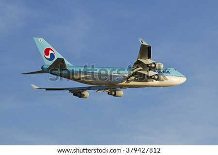 PRAGUE - August 08: Korean Air Boeing 747-400 airliner takes off on August 08, 2012 in Prague, Czech Republic.  Korean air is the flag carrier airline of South Korea. - stock photo