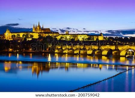 Prague castle and bridge at sunset, Czech republic. - stock photo