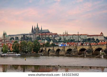Prague Castle and Charles bridge at sunset - stock photo