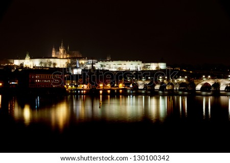 Prague castle at night with reflection on river