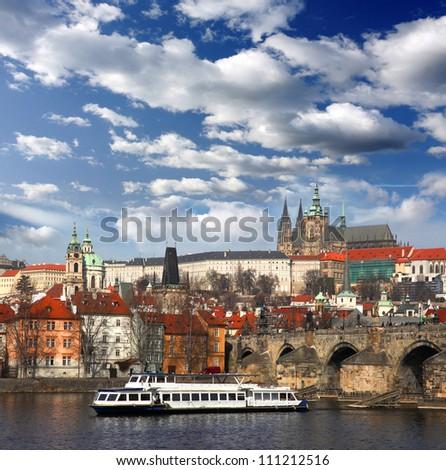 Prague Castle with famous Charles Bridge in Czech Republic - stock photo