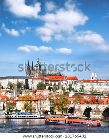 Prague Castle with famous Charles Bridge in Czech Republic - stock photo