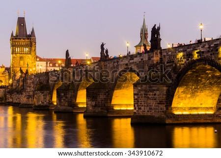 Prague, Charles Bridge and Lesser Tower at night, Czech Republic - stock photo