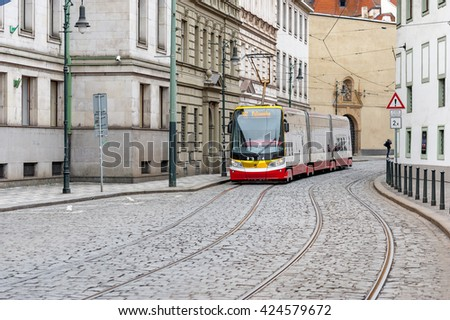 PRAGUE, CZECH - MARCH 12, 2016: Old Town Architecture of Prague. Tram and stone ground.