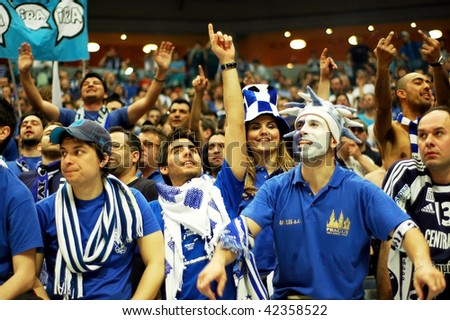 PRAGUE, CZECH REPUBLIC - APRIL 5: Iraklis team supporters watch the volleyball game of Final Four CEV Indesit Champions League at O2 Arena on April 5, 2009 in Prague. - stock photo