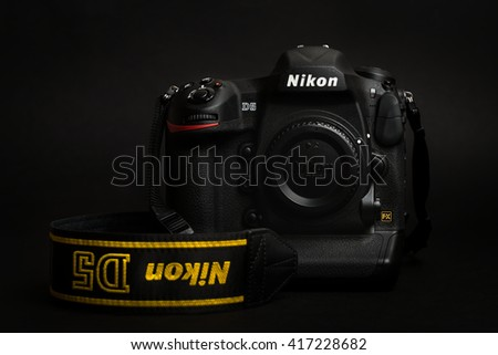 PRAGUE, CZECH REPUBLIC - APRIL 25, 2016: New professional top model camera, the DSLR Nikon D5, in studio with the dark background - stock photo
