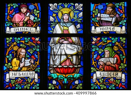 PRAGUE, CZECH REPUBLIC - APRIL 2, 2016: Stained Glass window in St. Vitus Cathedral, Prague, depicting Mother Mary and the Prophets Daniel, Jonah, Zachary and Abdias. - stock photo