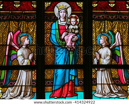 PRAGUE, CZECH REPUBLIC - APRIL 2, 2016: Stained Glass window in St. Vitus Cathedral, Prague, depicting Mother Mary, the Infant Jesus and angels - stock photo