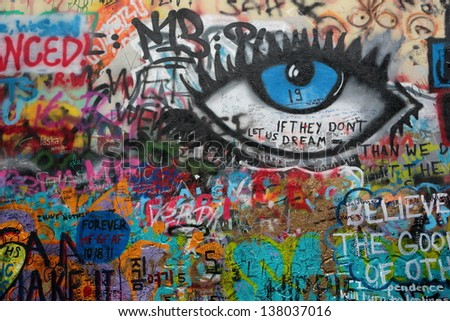 PRAGUE, CZECH REPUBLIC - APRIL 23:The Lennon Wall since the 1980s filled with John Lennon-inspired graffiti and pieces of lyrics from Beatles songs on Apr 23, 2013 in Prague, Czech Republic