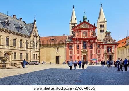 Prague, Czech Republic - April 23, 2015: The most oldest preserved romanesque church of the Prague Castle, St.George's Basilica was founded around 920. Prague, Czech Republic.  - stock photo