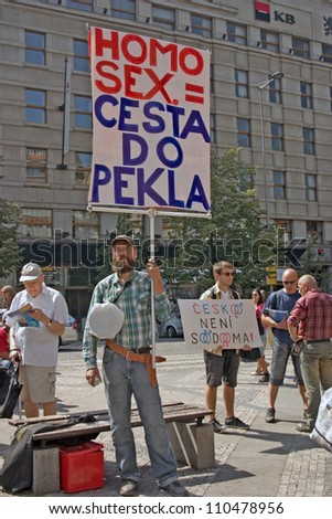 """PRAGUE, CZECH REPUBLIC - AUGUST 18: counter-protester, signs saying  """"Homosex. Road to Hell"""" + """"Czech Republic is not Sodom"""" at the 2. Prague Pride Parade, on August 18, 2012 in Prague, Czech Republic - stock photo"""