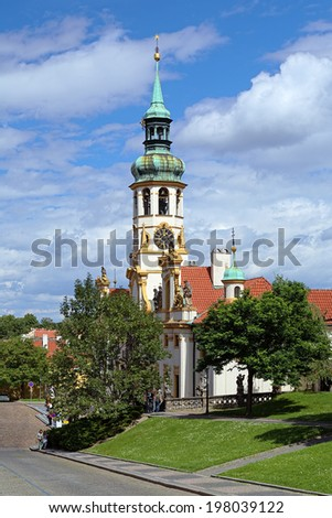 PRAGUE, CZECH REPUBLIC - AUGUST 24, 2010: Loreta - the pilgrimage destination in Hradcany district of Prague. The construction by design of Italian architect Giovanni Orsi had started in 1626.