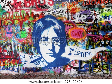 PRAGUE, CZECH REPUBLIC - AUGUST 19: The Lennon Wall since the 1980s is filled with John Lennon-inspired graffiti and pieces of lyrics from Beatles songs on august 05, 2014 in Prague, Czech Republic - stock photo