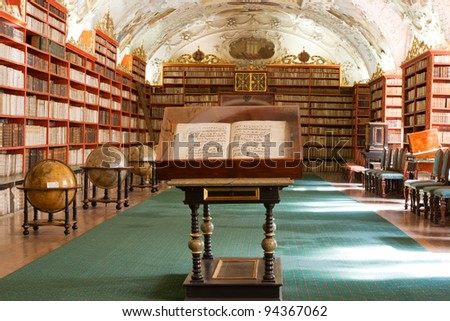PRAGUE, CZECH REPUBLIC - AUGUST 14: The Theological Hall in Strahov monastery with stucco decoration and paintings from 1720s on August 14, 2009 in Prague. Library with ancient books, globes - stock photo