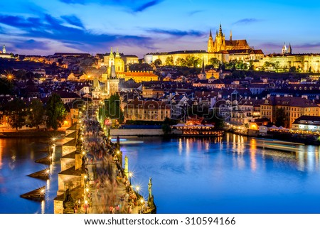Prague, Czech Republic. Charles Bridge and Hradcany (Prague Castle) with St. Vitus Cathedral and St. George church evening dusk, Bohemia landmark in Praha. - stock photo