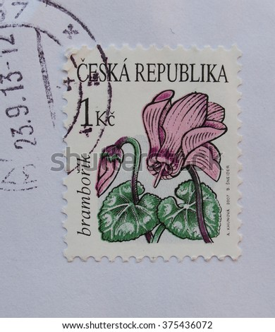 PRAGUE, CZECH REPUBLIC - CIRCA DECEMBER 2013: envelope with a Czech stamp with cyclamen flower (bramborik in Czech) - stock photo