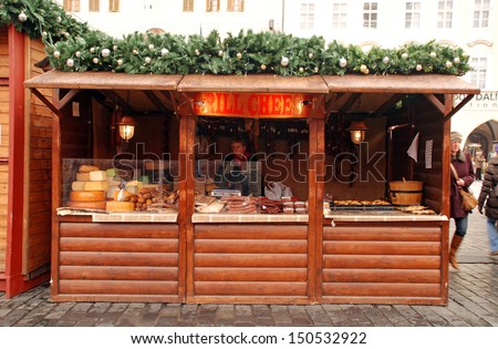 PRAGUE,CZECH REPUBLIC-DEC 29:Christmas market on Old Town Square at December 29,2011 in Prague,Czech Republic consist of decorated wooden huts selling traditional Czech hot food and handicrafts. - stock photo