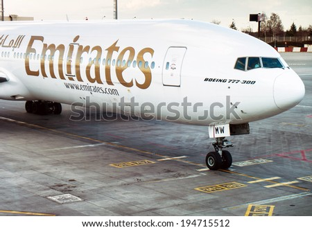 PRAGUE, CZECH REPUBLIC - FEBRUARY 22: Boeing 777-300 Emirates taxis for take off in PRG Airport on February  22, 2014. Emirates is an airline based in Dubai. - stock photo