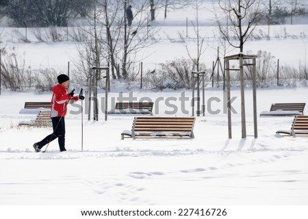 PRAGUE, CZECH REPUBLIC - FEBRUARY 24, 2013: Cross country skier run in Prague park. - stock photo