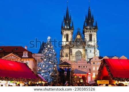 PRAGUE,CZECH REPUBLIC-JAN 05, 2013: Prague Christmas market on Old Town Square with gothic Tyne cathedral - stock photo