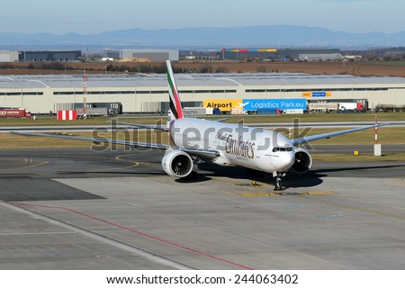 PRAGUE, CZECH REPUBLIC - JANUARY 13: Emirates Boeing 777-36N taxis at PRG Airport on January 13, 2015. Emirates  is one of two flag carriers of the UAE along with Etihad Airways and is based in Dubai. - stock photo