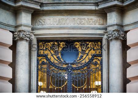 Prague, Czech Republic, January 04 2014: Ornamental gold gate in Palace of Assicurazioni Generali in the old city. - stock photo