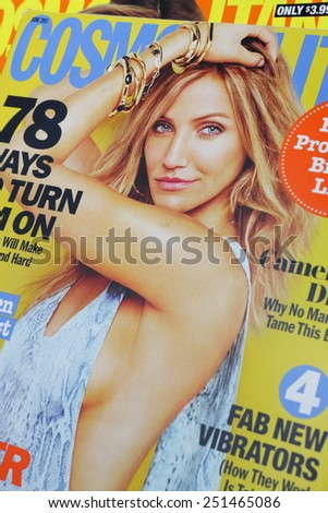 PRAGUE, CZECH REPUBLIC - JANUARY 24, 2014: stack of US edition of magazine Cosmopolitan, on top issue June 2011 with Cameron Diaz on cover, on display in Prague, Czech republic in January 2014 - stock photo