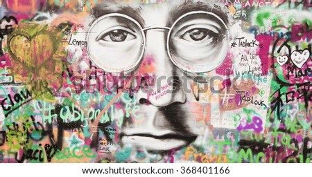 PRAGUE, CZECH REPUBLIC - JANUARY 04: The Lennon Wall since the 1980s is filled with John Lennon-inspired graffiti and pieces of lyrics from Beatles songs on January 05, 2016 in Prague, Czech Republic - stock photo