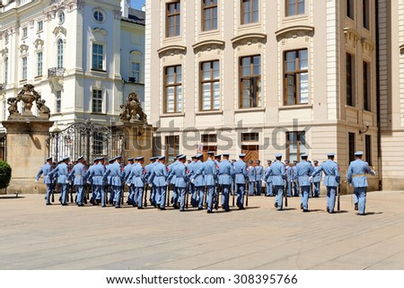 PRAGUE, CZECH REPUBLIC - JULY 4, 2014: Castle guards (Hradni straz) of presidential palace during ceremonial changing of guards. It takes place daily at noon, accompanied by a brass band.