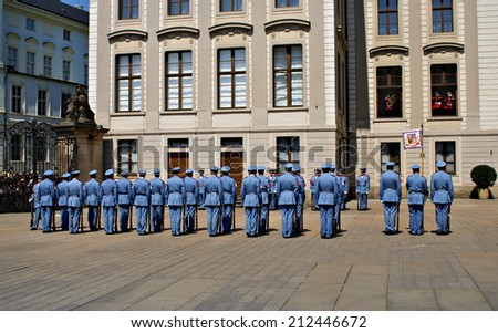 PRAGUE, CZECH REPUBLIC - JULY 19, 2014. Changing of the Guards Ceremony  takes place in the first courtyard of  Prague Castle at 12.00 daily and is a famous attraction for many tourists.