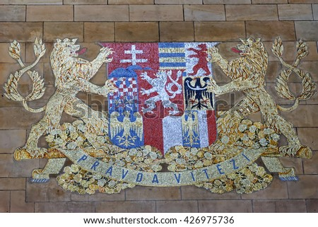 PRAGUE, CZECH REPUBLIC - JULY 4, 2014: Coat of Arms in the Gothic cathedral of Saint Vitus (The rotunda of St. Vitus) in district Mala Strana, Prague's old town. - stock photo