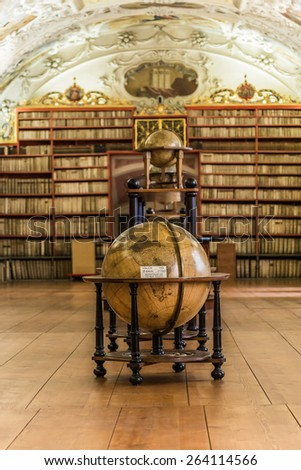 PRAGUE, CZECH REPUBLIC - JULY 11, 2014 :  The astronomical globes in the Theological Hall which is the historical library of Strahov Monastery in Prague - stock photo