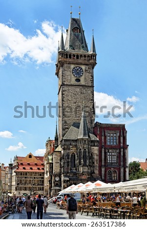 PRAGUE, CZECH REPUBLIC - JULY 3, 2014: The Old Town Hall with its tall Gothic tower in the Old Town Square. - stock photo