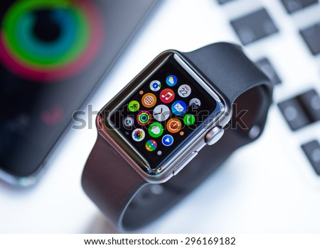 PRAGUE, CZECH REPUBLIC - June 22, 2015: New wearable Apple Watch smartwatch displaying the Apps. Apple Watch has fitness tracking and health-oriented capabilities with iOS products. - stock photo