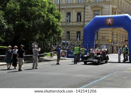 PRAGUE, CZECH REPUBLIC - JUNE 15: Parade of The Prague Club of Historic Cars, Historical car approaches the finish line. Moving blur, on June 15, 2013 in Prague, Opletalova Street, Czech Republic