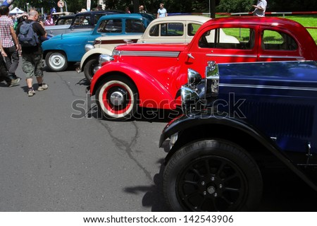 PRAGUE, CZECH REPUBLIC - JUNE 15: Parade of The Prague Club of Historic Cars, Visitors of the exhibition and the parade of old cars, on June 15, 2013 in Prague, Opletalova Street, Czech Republic.