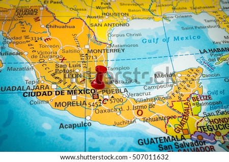 PRAGUE, CZECH REPUBLIC - JUNE 27, 2015: Red thumbtack in a map, pushpin pointing at Mexico city